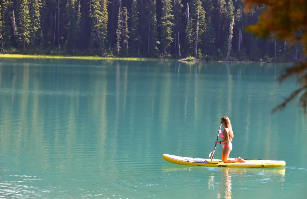 woman paddle boarding canadian lake