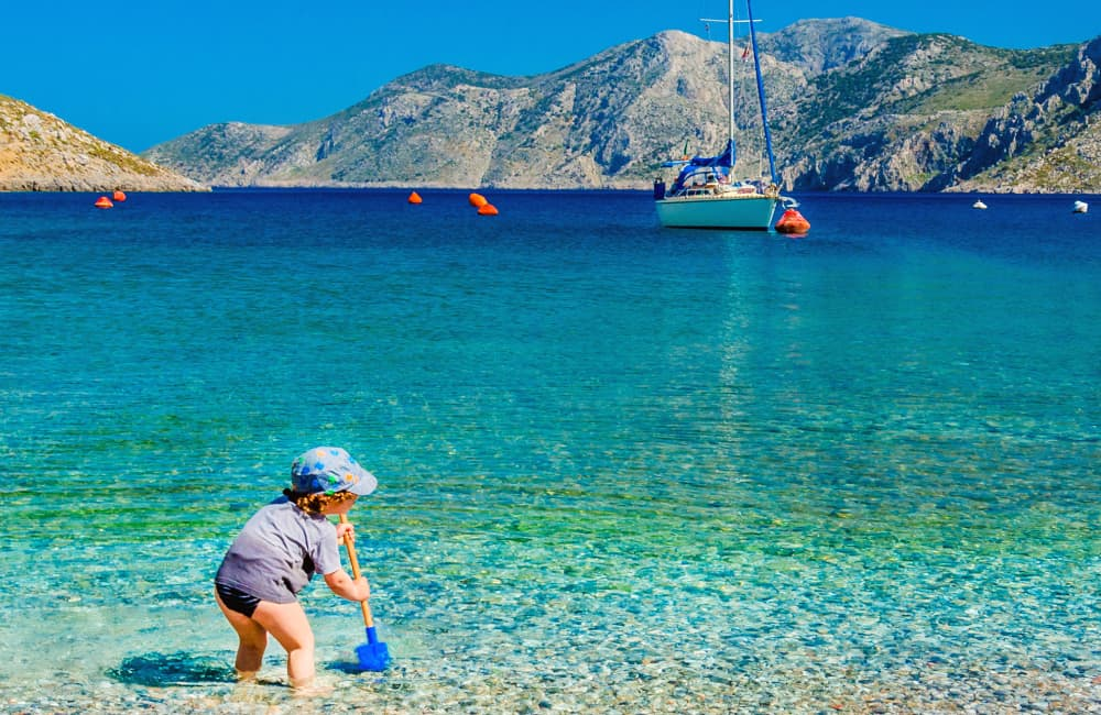 child playing Cyprus beach