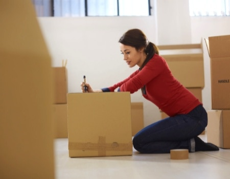 putting belongings into storage